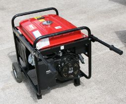 A Clarke FG4050ES 4.5kVA portable petrol generator fitted with pneumatic tyred wheels and twin