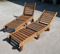 A pair of bespoke hand made hardwood sun loungers with adjustable backs, 203cms (6ft 8ins) fully