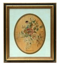 A 19th century oval silk needlework embroidery depicting flowers, framed & glazed, 24 by 30cms (9.