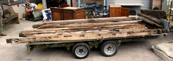 A quantity of oak beams and joists from a dismantled barn, possibly 17th / 18th century, approx 13ft
