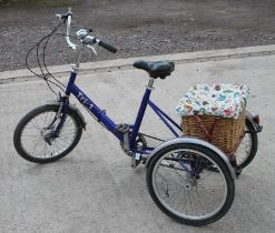 A Pashley Tri-1 tricycle with seven-speed gears and rear carrier with wicker basket.