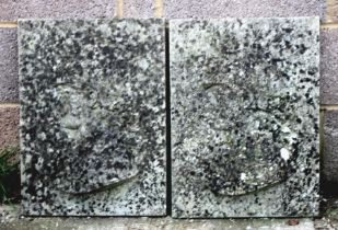A pair of composite stone wall plaques depicting classical busts, 39cms (15.5ins) wide.