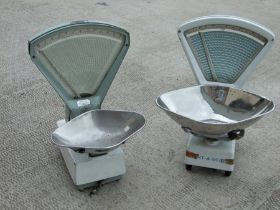 Two shop counter scales; together with a wicker shopping trolley and wicker basket (4).