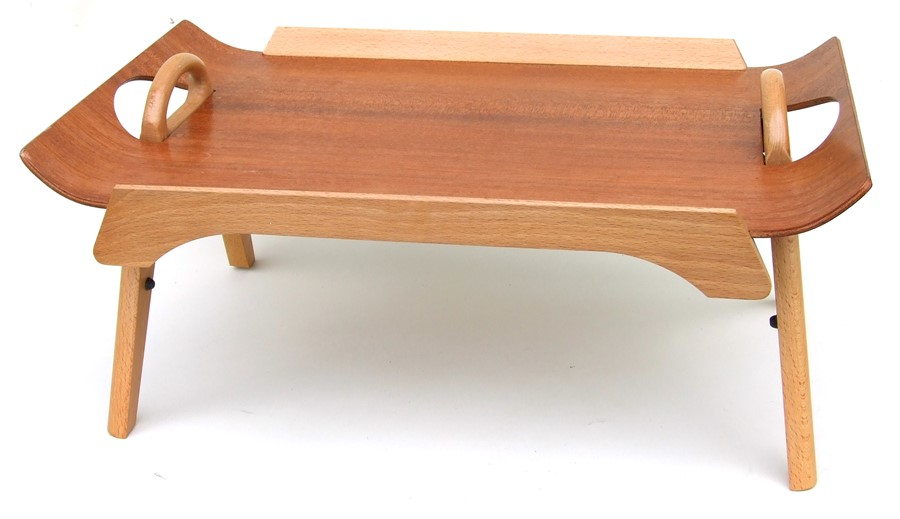 A mid 20th century design Centurion teak and beech folding bed table, 59cms (23.25ins) wide.
