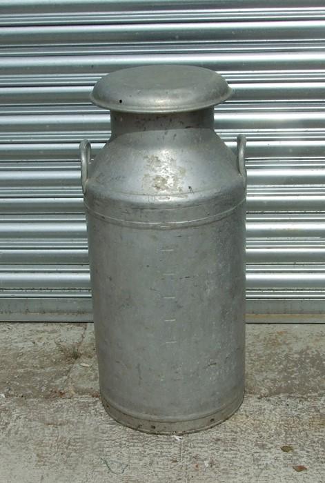 An Express Dairy Co. 10-gallon aluminium milk churn.