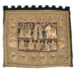 A large Burmese Kalaga tapestry wall hanging depicting numerous figures, mythical animals and