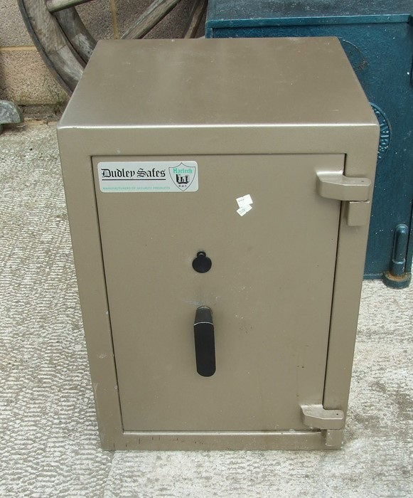 A Dudley Safes free standing safe with key, 46 by 64cms (18 by 25ins).