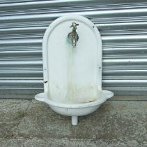 A French cast iron wall mounted enamel sink with cold water tap, 46cms (18ins) wide.Condition