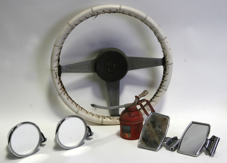 Assorted MG spares including a MG Midget steering wheel, seat belts, wing mirrors and other items.