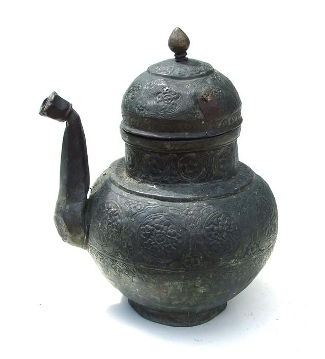 A Tibetan / Islamic tinned copper teapot, 28cms (11ins) high.