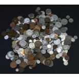 A collection of GB and foreign coinage including silver crowns and half crowns.