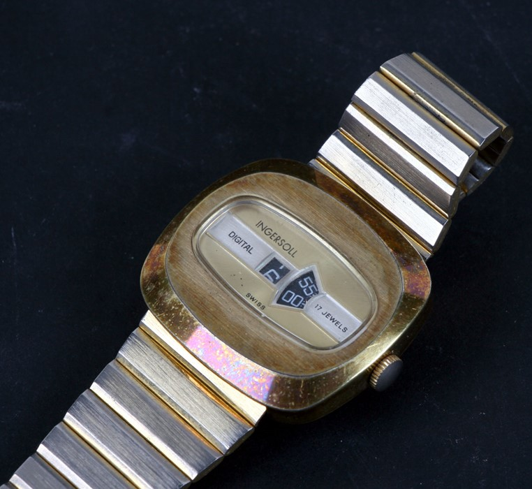 An gentleman's Ingersoll Jump Hour wristwatch with hour and minute apertures.