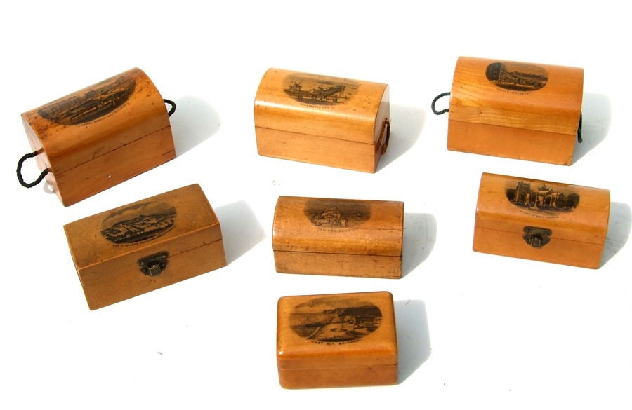 A collection of Victorian Mauchline ware to include dome top miniature trunks.