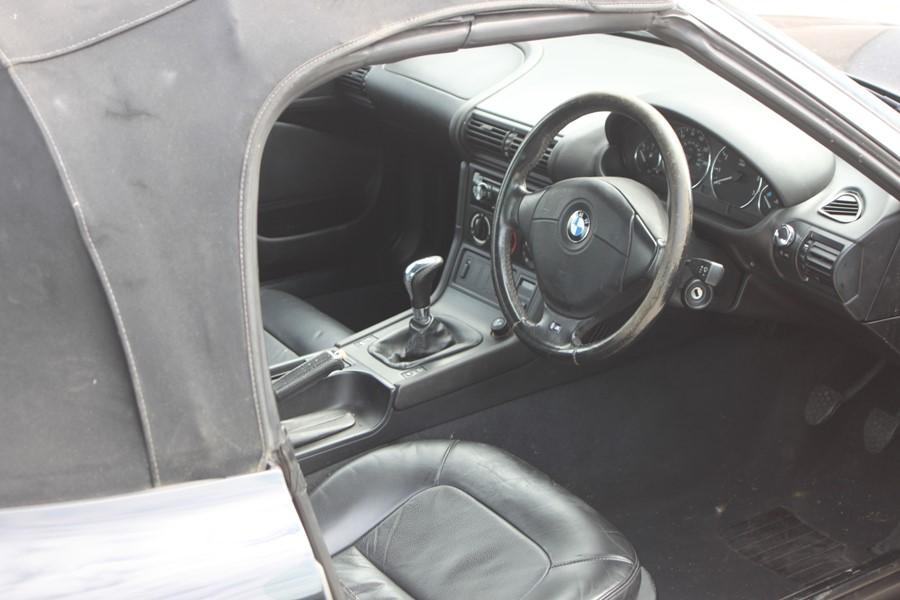 A 1999 BMW Z3 1.8 Roadster, registration number T774 JNW, black. Finished in black with a black - Image 6 of 10