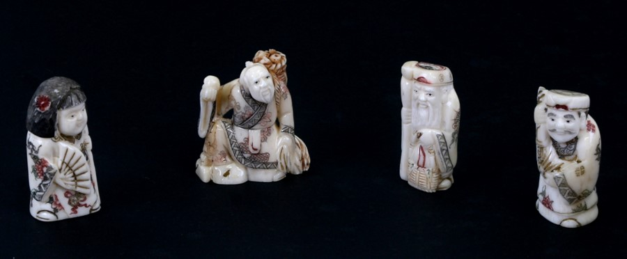 A group of four Chinese bone figures, 5cms (2ins) high (4).