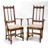 A pair of Ercol carver chairs.