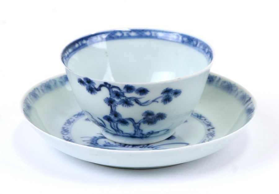 An 18th century Chinese Export blue & white tea bowl and saucer from the Nanking Cargo, bearing