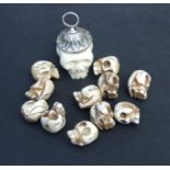 A carved bone skull form pendant; together with a quantity of bone skull form loose beads.