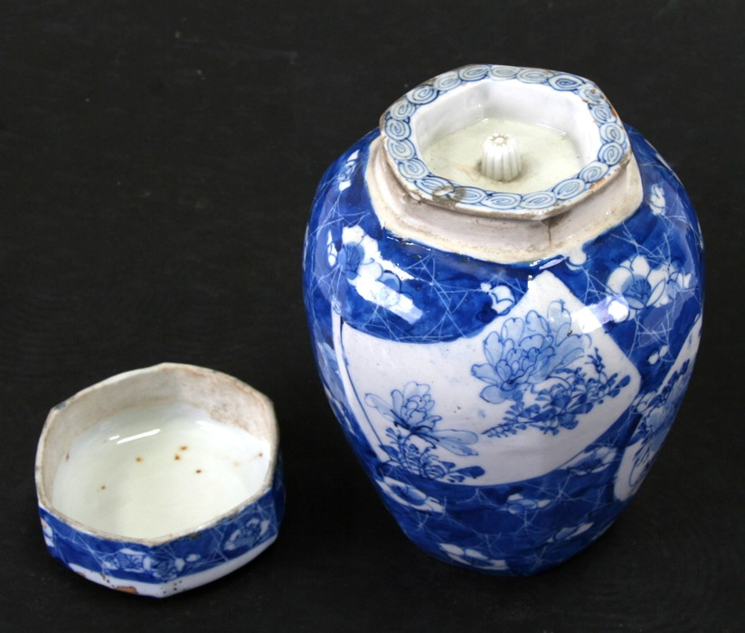 A Japanese blue & white ginger jar and cover decorated with flowers and fruits, 20cms (8ins) high; - Image 5 of 6