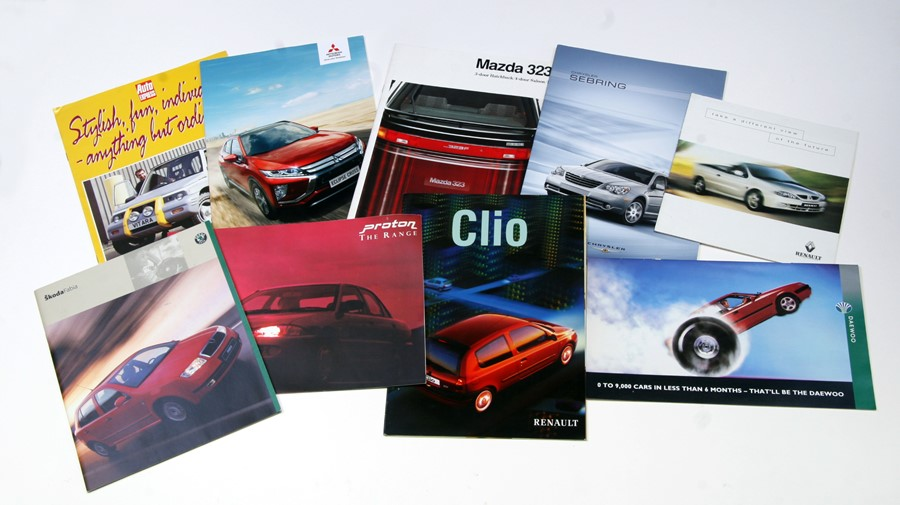 A collection of car sales brochures including, Mini, Ford, Vauxhall, Suzuki, Renault and others.