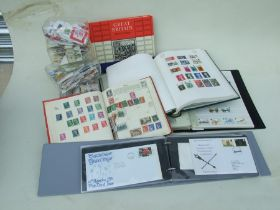 A large quantity of stamp albums, mainly British, including First Day covers; together with a