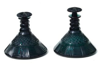A pair of 19th century facet cut green glass ships decanters and stoppers, 20cms (8ins) diameter (