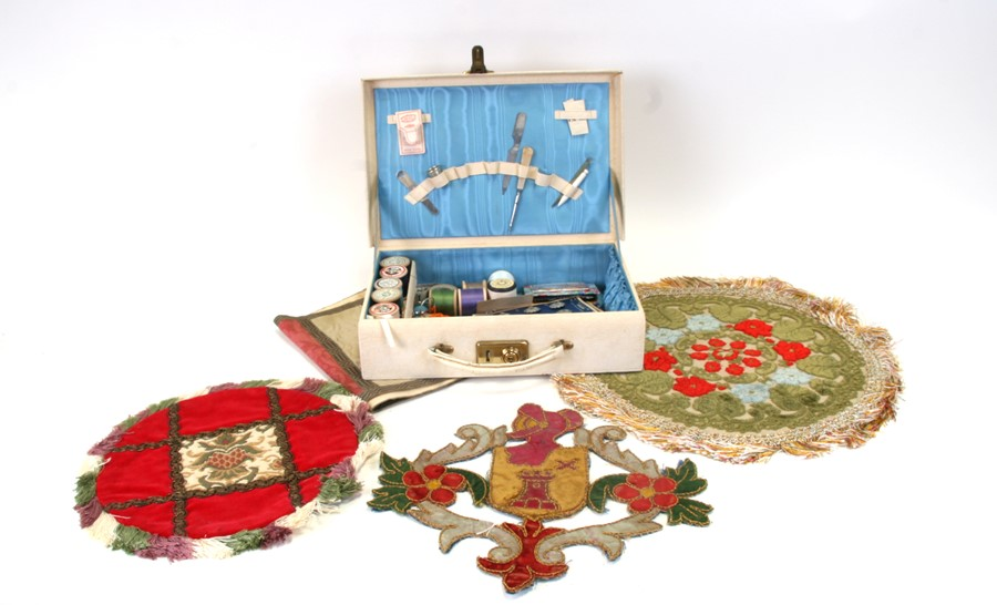 A quantity of assorted sewing accessories; together with embroidered panels.