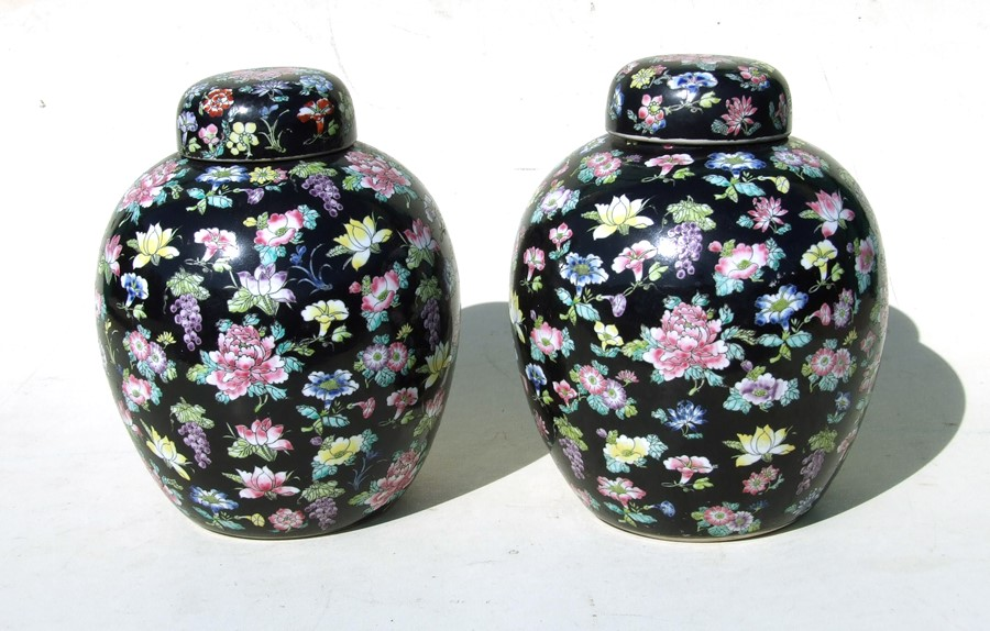 A pair of large Chinese famille noir ginger jars and covers. 28cm (11 ins) high