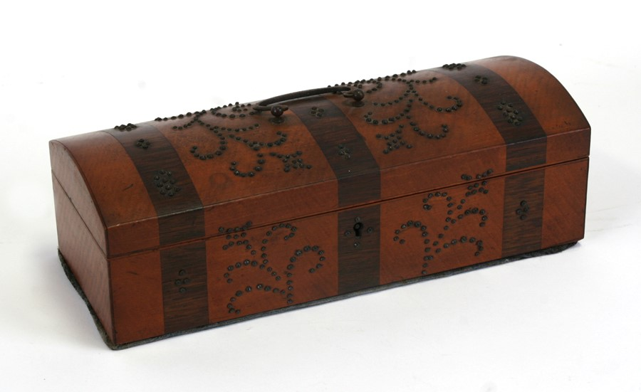 A 19th century banded dome top glove box with steel studwork decoration, 25cms (9.75ins) wide.