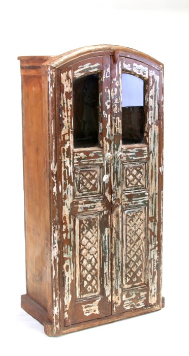 A distressed painted two-door teak cupboard, 64cms (25ins) wide.