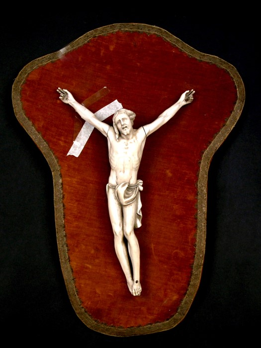 An 18th / 19th century French ivory Corpus Christi mounted on a velvet board, the figure 36cms (