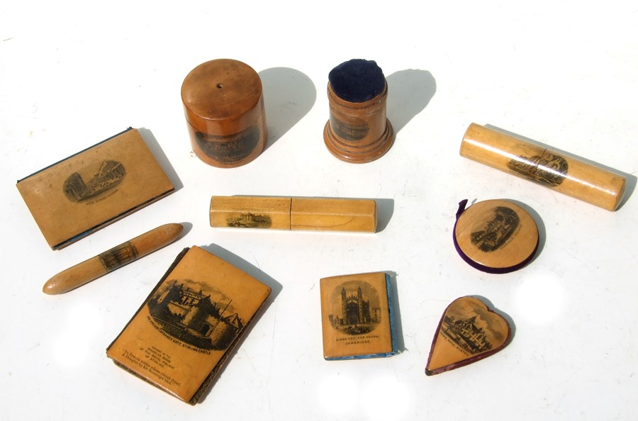 A collection of Victorian sewing related Mauchline ware to include pin cushions and bodkin cases.
