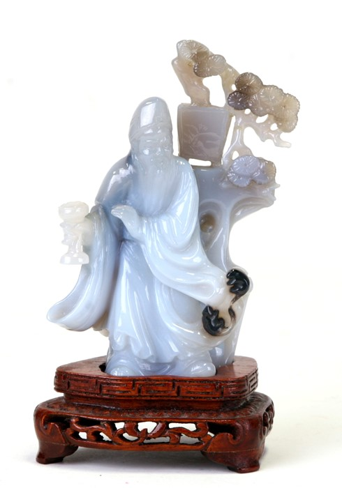 A Chinese carved agate figure depicting a robed man standing beside a tree, on a hardwood stand, - Image 2 of 5