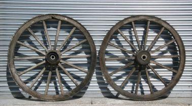 A pair of iron bound cart wheels, 117cms (46ins) diameter (2).