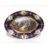 A Sevres oval porcelain cabinet plate, the central panel depicting Le Mort de Gaston de Foix en 1512