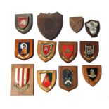 A group of military and similar shield shaped plaques to include The Sultan's Armed Forces, Nigerian