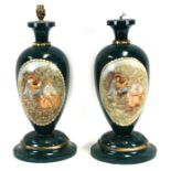 A pair of painted wooden table lamps, 49cms (19.25ins) high.