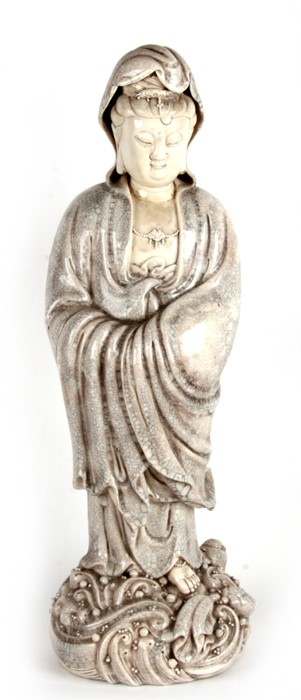 A Chinese white crackle glaze figure, depicting Guan Yin. 71cm (28ins) high