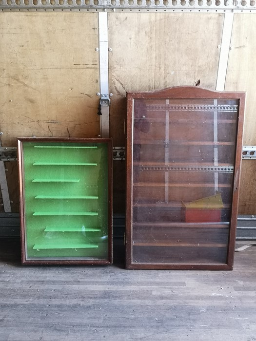 A mahogany wall hanging display cabinet with single glazed panelled door enclosing seven shelves