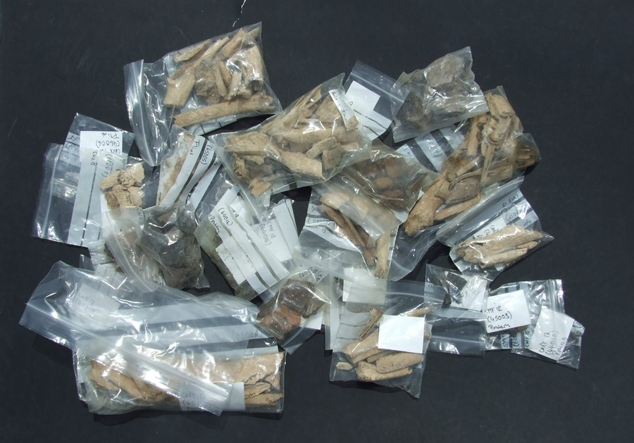A large quantity of archaeology finds to include prehistoric pottery, Roman pottery and flints;