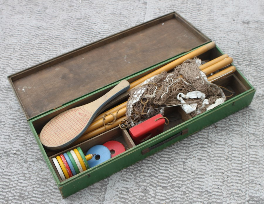 An early 20th century boxed set of lawn tennis.