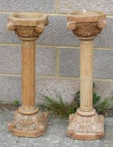 A pair of faux marble or plaster columns on pedestals, approx. 76cms (30ins) high (2). (a/f)