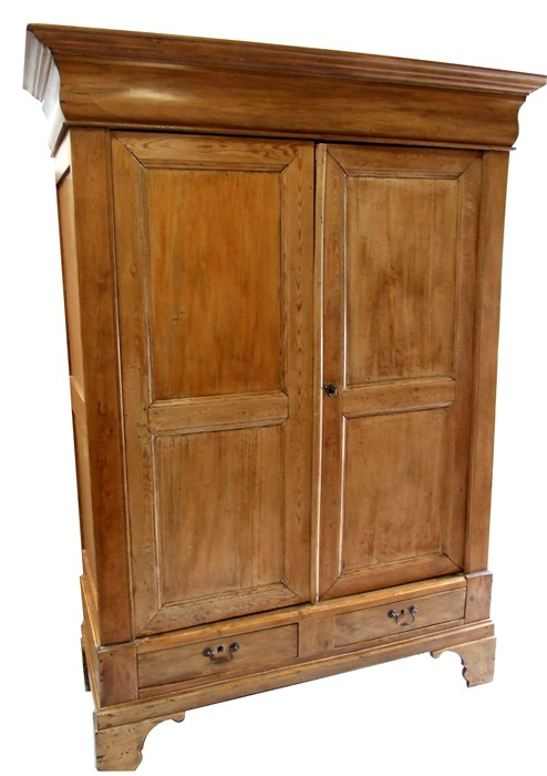 A French fruitwood and pine armoire, the pair of panelled doors above two short drawers, 149cms (