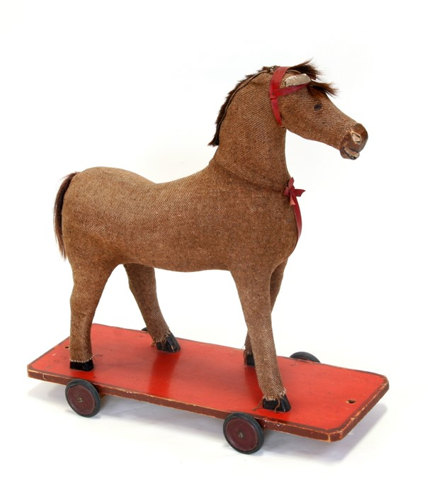 A vintage pull-along horse, 63cms (25ins) wide.