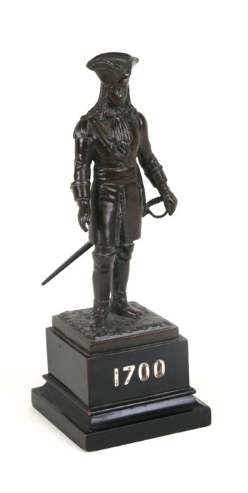 An early 20th century bronze figure of a British soldier in uniform from the 1700's, finely cast