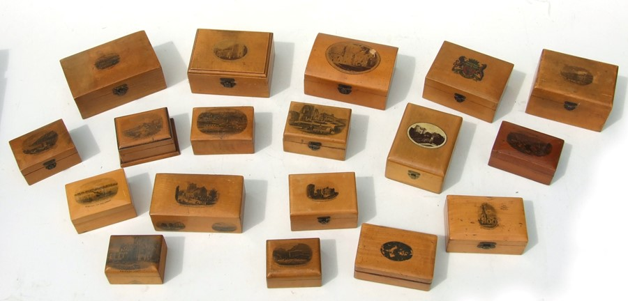 A collection of Victorian Mauchline ware small boxes.