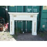 A large Adams style painted fire surround with carvings of the Green Man and inset granite panels,
