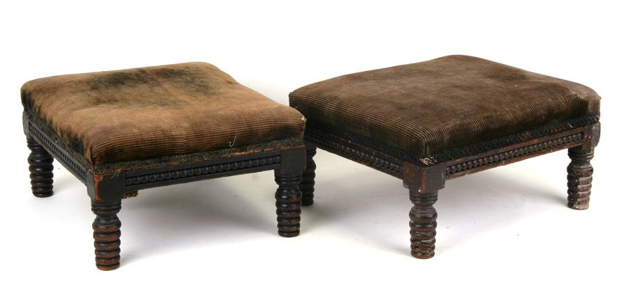 A pair of 19th century small mahogany footstools with upholstered seats on ring turned legs,