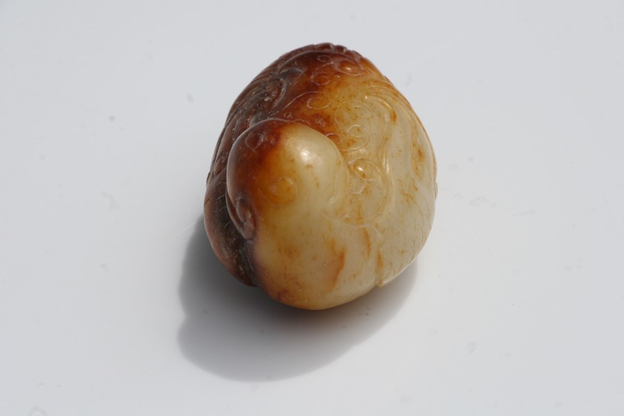 A Chinese russet jade figure of a quail mounted on a hardwood stand, 5.5cms (2.25ins) long. - Image 5 of 9