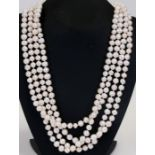 A single strand freshwater cultured pearl necklace, 264cms (104ins) total length, each pearl